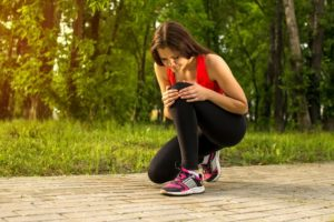 Woman in pain while running in centreville park, knee injury, pain