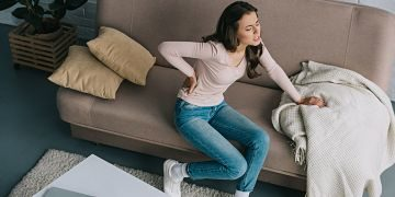 Why is my sciatic pain worse after sitting on the couch?